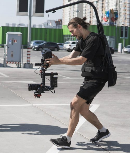Image of our staff at Elite Video of Bend shoowing some footage out in a parking lot.